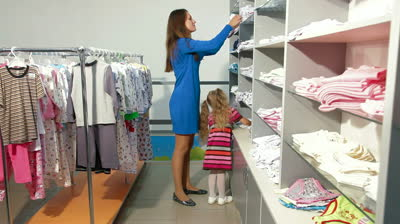 stock-footage-mother-and-little-daughter-shopping-for-girls-clothes-in-a-clothing-store-looking-kids-underwear