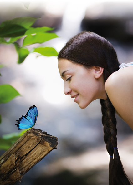 Woman Examining Butterfly