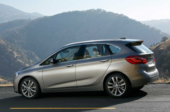 2016-bmw-2-series-active-tourer-on-road-lights-on-side-view