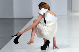 A model takes her shoe off after she fel