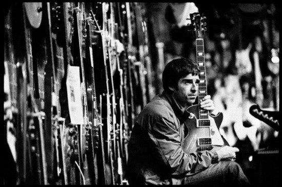 Noel Gallagher in a guitar shop Credits: Jill Furmanovsky