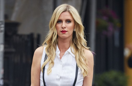Nicky Hilton seen wearing tuxedo tank top, suspenders and skirt while shopping in the East Village neighborhood of NYC